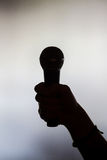 Hand holding a microphone stock images