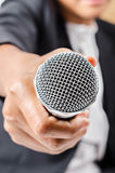 Hand holding a microphone. Stock Image
