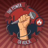 Hand holding a microphone in a fist. the power of rock retro  poster.  illustration. Hand holding a microphone in a fist. the power of rock retro poster Stock Photo