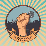 Hand holding a microphone in a fist. retro rock. Poster. vector illustration Royalty Free Stock Images