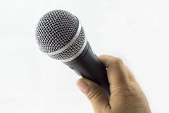 Hand holding microphone Royalty Free Stock Photos