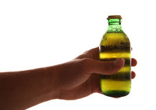 Hand holding a mini bottle of larger. Cutout Stock Photography