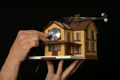 Hand holding miniature house Royalty Free Stock Image