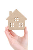Hand holding miniature model of house Stock Photography