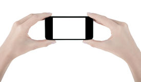 Hand holding mobile phone Stock Images