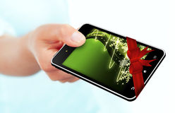 Hand holding mobile phone with christmas screen over white backg Royalty Free Stock Photography