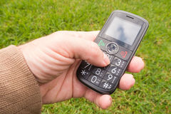 Hand holding mobile phone Royalty Free Stock Image
