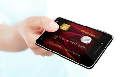 Hand holding mobile phone with credit card screen Royalty Free Stock Images