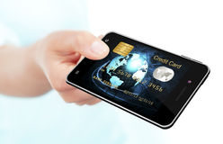 Hand holding mobile phone with credit card screen stock image