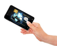 Hand holding mobile phone with credit card screen Royalty Free Stock Photography
