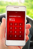 Hand holding mobile phone with emergency number 911 Stock Images