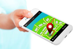 Hand holding mobile phone with gps application and map over whit Royalty Free Stock Photos