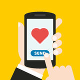 Hand holding a mobile phone with an icon and button. Finger touches screen. It can be used for a website, mobile application, pres. It can be used for a website Stock Images
