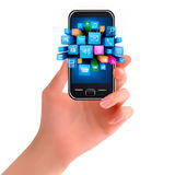 Hand holding mobile phone with icons Stock Photo