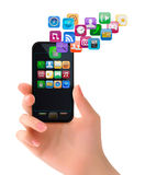 Hand holding mobile phone with icons. Stock Images