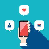Hand holding mobile phone with icons and speech bubbles Social network concept. Vector illustration Stock Images
