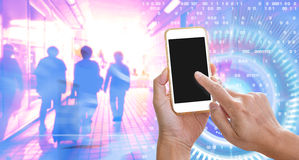 Hand holding mobile phone with internet of things. On screen Royalty Free Stock Image