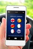 Hand holding mobile phone with language learning application Royalty Free Stock Image
