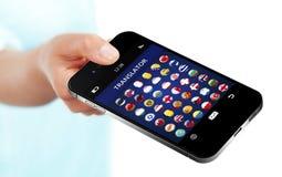 Hand holding mobile phone with language translator application o. Ver white background Stock Image