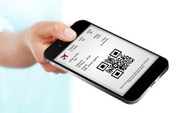 Hand holding mobile phone with mobile boarding pass. Isolated over white background Stock Photography