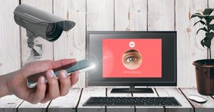 Hand holding mobile phone with Security camera watching laptop identity App Interface. Digital composite of Hand holding mobile phone with Security camera royalty free illustration