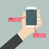 Hand holding mobile phone.Social network concept.Messenger windo Stock Photo