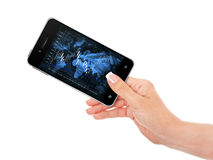 Hand holding mobile phone with stock market chart Royalty Free Stock Photography