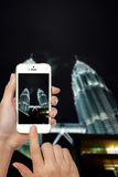 Hand Holding Mobile Phone Taking Picture Stock Image