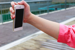Hand holding mobile phone. Woman hand holding mobile phone for taking photo Stock Photos