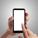 Hand holding mobile smart phone Royalty Free Stock Images
