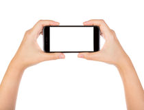 Hand holding mobile smart phone with blank screen Isolated Royalty Free Stock Images