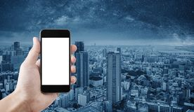 Hand holding mobile smart phone, empty white screen, Osaka city, Japan background stock photo