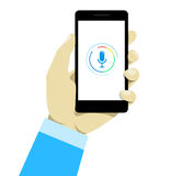 Hand holding mobile smart phone with voice control. Stock Photography