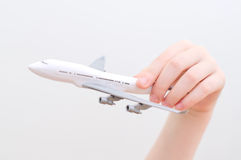 Hand holding model airplane. Royalty Free Stock Photo