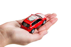 Hand holding model of a car. A hand holding the model of a car. symbolic photo for car purchase stock image