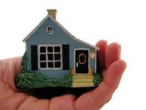 Hand holding model house Stock Photos