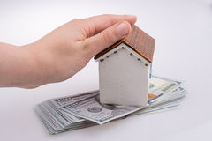 Hand holding  a model house by the side of Turkish Lira banknote Stock Photography