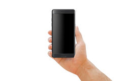 Hand holding modern black smartphone with curved edge for mockup. Stock Photography