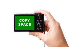 Hand holding modern digital camera Royalty Free Stock Photography