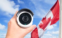 Hand holding modern surveillance camera Royalty Free Stock Image