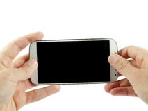 Hand holding a modern white smartphone Stock Photography