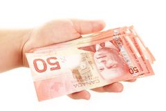 Hand Holding Money. Hand holding Canadian fifty dollar bills Stock Photography