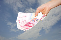 A hand holding money Royalty Free Stock Photography