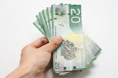 Hand holding money. In white isolated background Stock Image