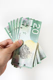 Hand holding money. In white isolated background Stock Images