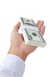 Hand holding money. On white background Royalty Free Stock Photography