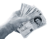 Hand holding money. Photo of a Hand holding money Royalty Free Stock Image