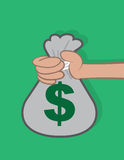 Hand Holding Money Bag Stock Image
