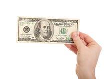 Hand holding money dollars, 100 US dollar. Female hand holding money dollars, 100 US dollar banknote isolated on white background Royalty Free Stock Images