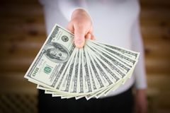 Hand holding money dollars Stock Photography
